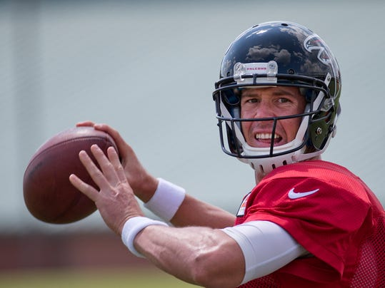 Atlanta Falcons quarterback Matt Ryan (2) throws during an NFL football training camp Tuesday, July 29, 2014 in Flowery Branch, Ga.  For the first time, Ryan is trying to lead the Falcons back from a losing season, and he is without one of his top targets, tight end Tony Gonzalez, who has retired.  (AP Photo/John Bazemore)