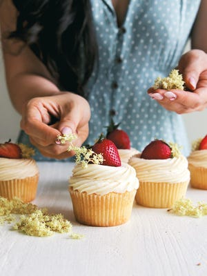 """Lemon-Ricotta Cupcakes with Lemon-Elderflower Buttercream is an accessible recipe from """"Blooms and Baking,"""" a new cookbook by Amy Ho. And they look so summery."""