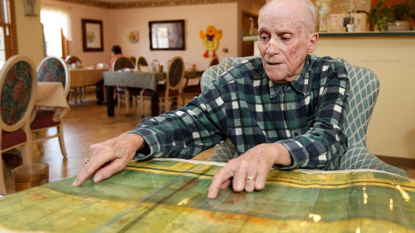 Ed Gilleran of Helena uses a map he brought back from the June 6, 1944, D-Day invasion to talk about his experience as an U.S. Army soldier.