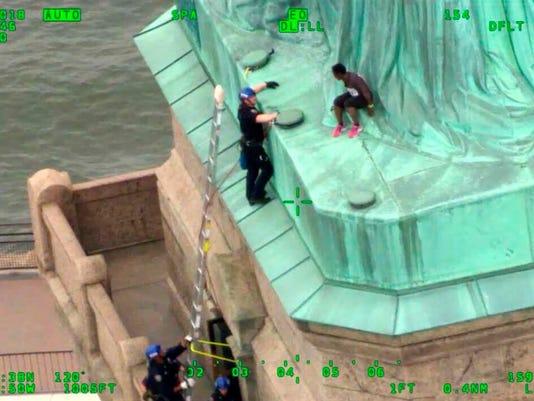 636664027192091945-AP-Statue-of-Liberty-Arrests.jpg