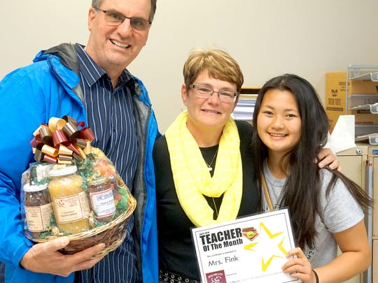 Pictured, from left, are: Dave Brown, vice president of Brown's Orchards; Melinda Fink, calculus teacher at York County School of Technology; and Lisa Nguyen, student.