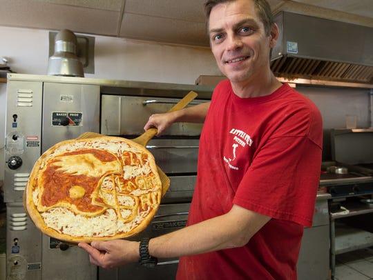 Pizza artist, Brian Clossen, shows a Philadelphia Eagles