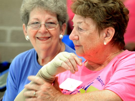Sisters Beverly Botterbusch of Manchester Township, left, and Shirley Wilt of Newberry Township chat while watching the shuffleboard competition during the York County Senior Games at Central York High School Wednesday, June 20, 2018. The annual senior games are organized by the York County Area Agency on Aging. Bill Kalina photo