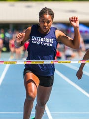 Jaslyn Gardner crosses the finish line to win the 100