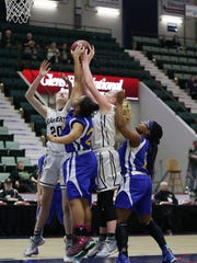 A host of Aquinas and Susquehanna Valley players battle under the basket during Sunday's Class B final at the Federation Tournament of Champions.