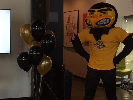 Herky the Hawk watches as Iowa City's RAGBRAI XLVI