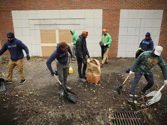 "In this Feb. 15, 2019, photo, workers take part in Fresh Start initiative clean up trash in the Germantown neighborhood of Philadelphia. Philadelphia has been trying for years to shed itself of the nickname ""Filthadelphia."" Now some neighborhoods struggling with litter have decided to take collection into their own hands. One has gone so far as to buy its own trash truck. (AP Photo/Matt Rourke)"