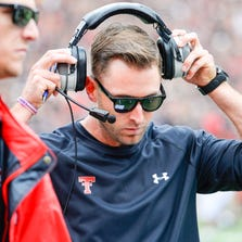 LUBBOCK, TX - SEPTEMBER 13: Head coach Kliff Kingsbury of the Texas Tech Red Raiders walks the sidelines during game action against the Arkansas Razorbacks on September 13, 2014 at Jones AT&T Stadium in Lubbock, Texas. Arkansas defeated Texas Tech 49-28. (Photo by John Weast/Getty Images)