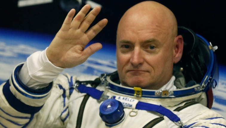 NASA Astronaut Scott Kelly has his space suit checked