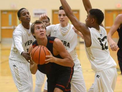 Cocoa Beach's Harrison Van Horn is surrounded by Viera players as he tries to shoot during their game Tuesday evening.