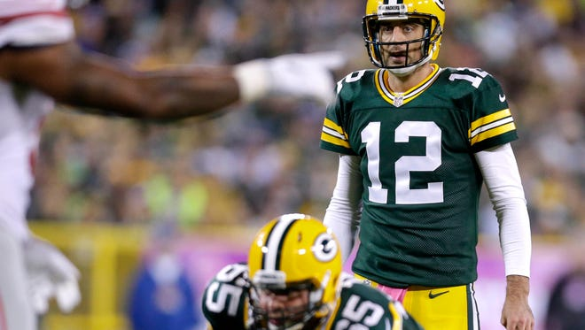 Green Bay Packers quarterback Aaron Rodgers (12) reads the defense before snapping the ball during a 23-16 win over the  New York Giants NFL football game at Lambeau Field in Green Bay, WI, Sunday, October 9, 2016.
