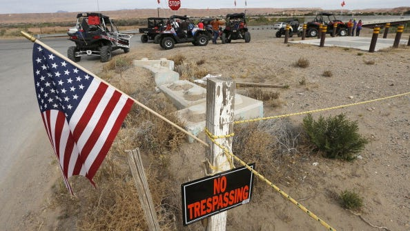 An American flag flies as ATV riders prepare to enter closed BLM land  along U.S. 170 on April 11, 2014 west of Mesquite, Nevada.