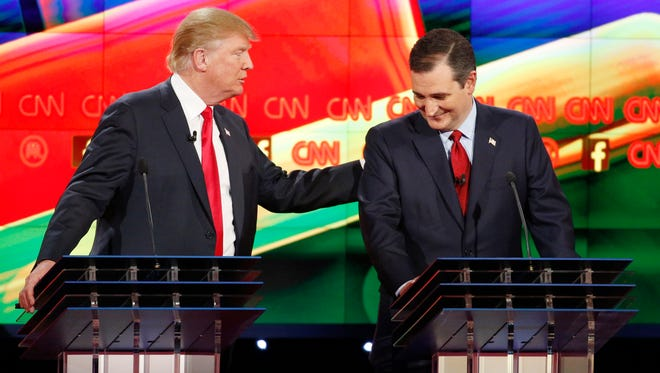 Donald Trump, left, and Ted Cruz joke about remarks Cruz has made about Trump's temperament during the CNN Republican presidential debate at the Venetian Hotel & Casino on Tuesday, Dec. 15, 2015, in Las Vegas.