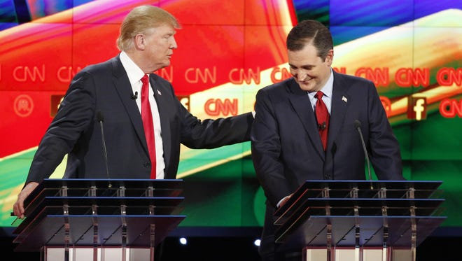 Donald Trump, left, and Ted Cruz joke about remarks Cruz has made about Trump's temperament during the CNN Republican presidential debate at the Venetian Hotel & Casino on Tuesday in Las Vegas.