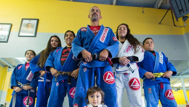 The Benitez family are the proud owners of Gracie Barra Las Cruces, a Brazilian jiujitsu schoo, lat 421 Avenida de Mesilla. From far left to right, is daughter Nevaeh, 9; daughter Jaylynn 16; mother Angela, 38; father Jacob, 39; son Jacob, 2, in foreground, daughter Alyssa, 19, and son Gabriel, 12.