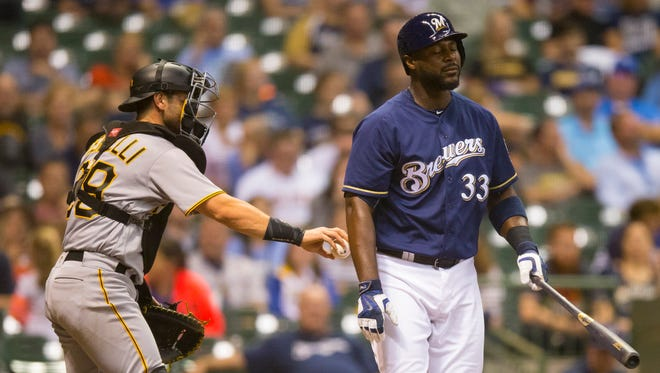 Pirates catcher Francisco Cervelli tags out Brewers first baseman Chris Carter to complete the strikeout during the third inning at Miller Park.