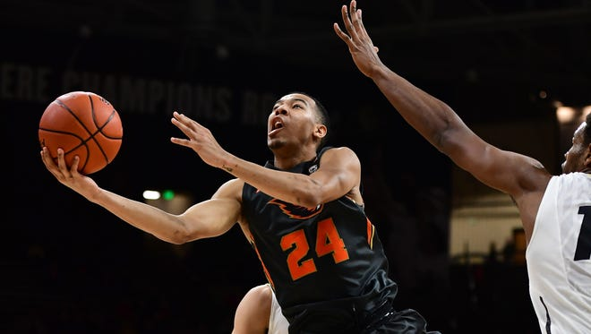 Oregon State Beavers guard Kendal Manuel (24) attempts a basket in the second half against the Colorado Buffaloes at Coors Events Center. The Buffaloes defeated the Beavers 85-78.
