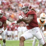 Alabama Crimson Tide running back Derrick Henry (2) carries for a touchdown against the Tennessee Volunteers during the first quarter at Bryant-Denny Stadium.