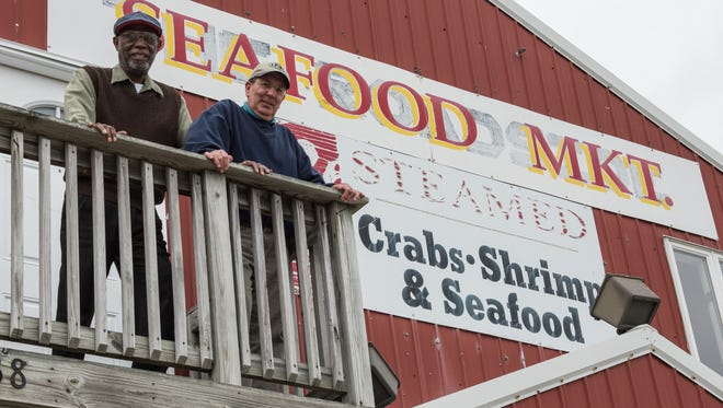 UMES Agriculture Professor, Arthur Allen, left, and Beach to Bay proprietor, Richard Evanusa pose for a photo on Tuesday, May 10, 2016.