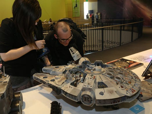 """Roman and Bria Gamble of Des Moines check out a replica of Han Solo's space ship during the """"May the 4th"""" festival at the Science Center of Iowa Sunday, May 4, 2014."""