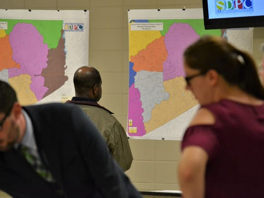 Parents and community members looked at blown-up maps