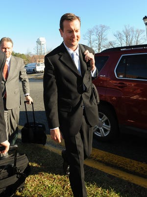 NASCAR driver Kurt Busch arrives for a protective order hearing at Kent County Family Court on Dec. 17. Busch will not be charged by the Delaware Attorney General related to a September domestic violence case, it was announced Thursday.