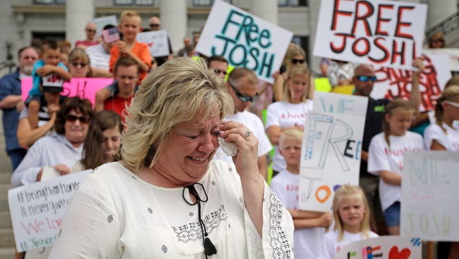 In this July 30, 2016, file photo, Laurie Holt, the mother of Josh Holt, an American jailed in Venezuela, cries during a rally at the Utah State Capitol, in Salt Lake City. U.S. congresswoman Mia Love said Wednesday, Aug. 31, 2016, she will call on the State Department to do more to free Josh Holt, a Utah man who's been jailed in Venezuela for two months on weapons charges.