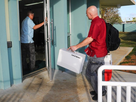 An unidentified man is allowed to enter the Guam Housing