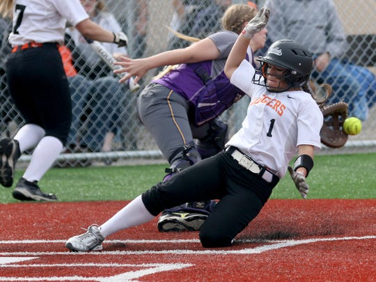 Scio's Ashton Phillips (1) slides safely into home past Harrisburg's McKenzie Thompson (2) in the Harrisburg vs. Scio softball game, in the quarterfinals of the OSAA Class 3A state playoffs, at Scio High School in Scio, Ore., on Friday, May 27, 2016. Scio won the game 10-0 in five innings.
