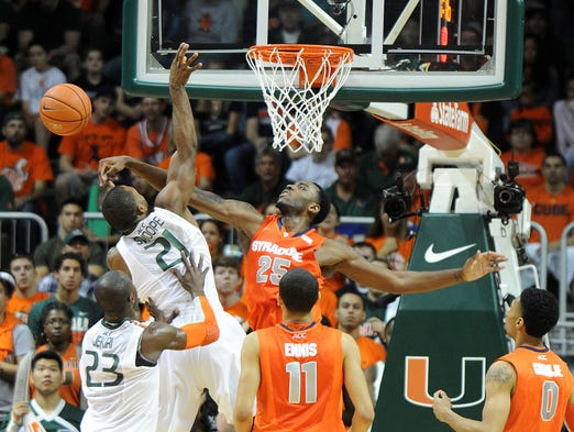 Syracuse forward Rakeem Christmas  blocks the shot from Miami forward Erik Swoope during the first half on Jan. 25, 2014, in Miami.