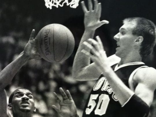 Matt Bullard, right, played at West Des Moines Valley and Iowa. He was a member of the Houston Rockets 1994 NBA championship team.