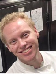 Joshua L'Heureux, 22, in his uniform at work. He died