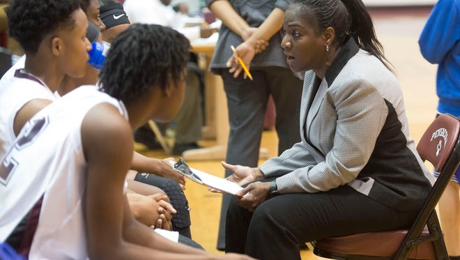 Pensacola High School's girls' basketball coach Alison Davis, right, talks with her players before the start of Thursday night's Region 1-7A quarterfinals game against Choctawhatchee High.
