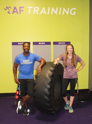 Head Personal Trainer Donny Hill and Gym Manager Sky Thornburg of Anytime Fitness, which recently moved into its new facility in University Plaza.