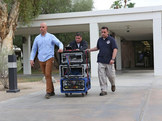 Members of the Inland Empire public corruption task force remove computer servers from Palm Springs City Hall, after a raid Tuesday, September 1, 2015.