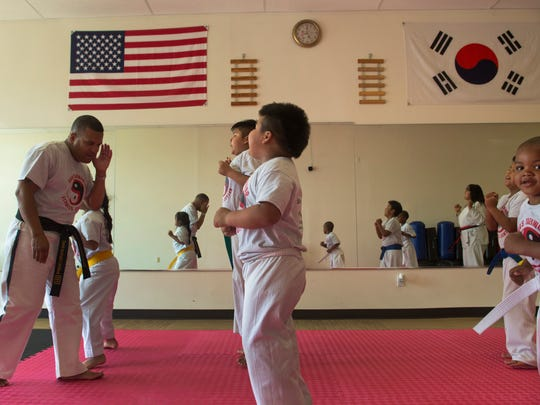 Steve Shealaynosun leads a class of youngsters at his Shea's Taekwondo & Fitness Center in Neptune City.