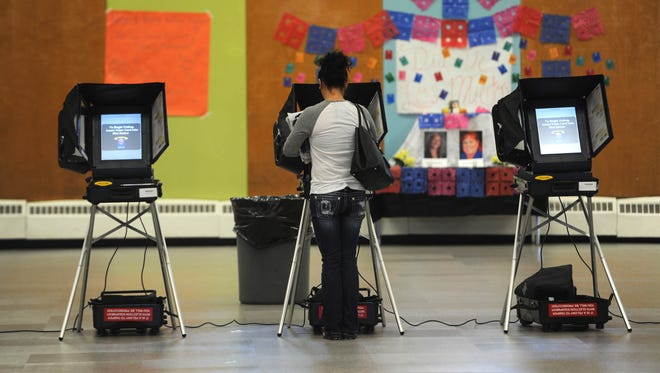 Voters cast their ballots at Hug High School in Reno on Nov. 8, 2016.