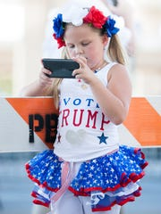 Laci Lamb, 7, of Lucedale, Miss., plays a video game