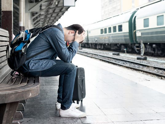 traveler waiting at train station after mistakes