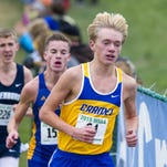 Carmel senior Ben Veatch (64) leads the runners along the course during the IHSAA Cross Country State Championship race at LaVern Gibson Championship Cross Country Course in Terre Haute, Oct. 31, 2015.