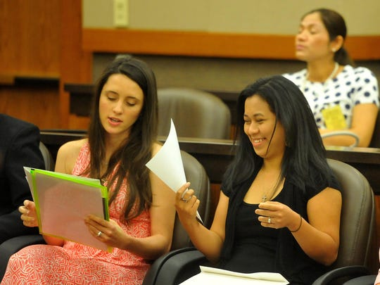 Camila Maloy, left, and Catherine Mosher chat before the start of their naturalization ceremony on Thursday in the Missouri River Federal Courthouse.