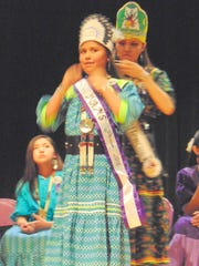 Makayla Rocha is crowned Middle School incoming princess by Miss Mescalero Autumn Pilcher.