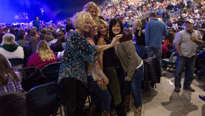 Women gather for a photo prior to the Little Big Town concert at the BMO Harris Bradley Center last week. The facility, which opened in 1988, has only a few more scheduled events before it is demolished.