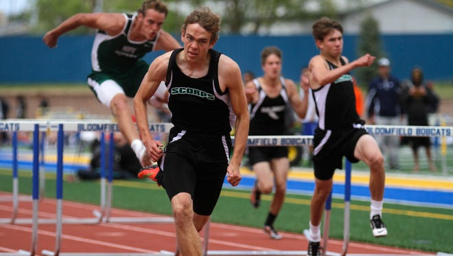 Farmington's Tanner Waite finishes first with teammate Berrett Bentley, right, taking third in the boys 110-meter hurdles on Saturday at the Bloomfield Invitational at Bobcat Stadium.