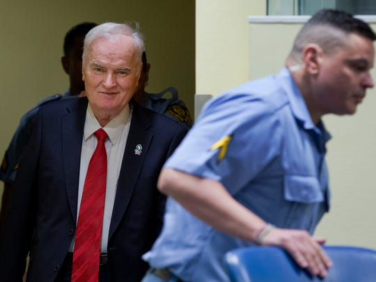 Bosnian Serb military chief Ratko Mladic, left, enters