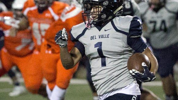 Del Valle wide receiver Kevin Cortez, 1, picks up yardage