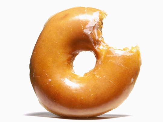 Glazed doughnut with missing bite
