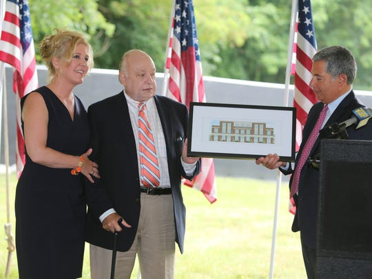 Roger Ailes and his wife Elizabeth receive a framed rendering from property owner Paul Guillaro, during a groundbreaking for the Pataki Park and the now-shelved Roger Ailes Senior Center  in Cold Spring, July 8, 2015.
