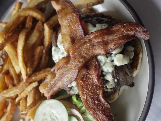 The Canary burger at Prairie Canary restaurant in Grinnell. The burger is topped with blue cheese, caramelized red onion and bacon.