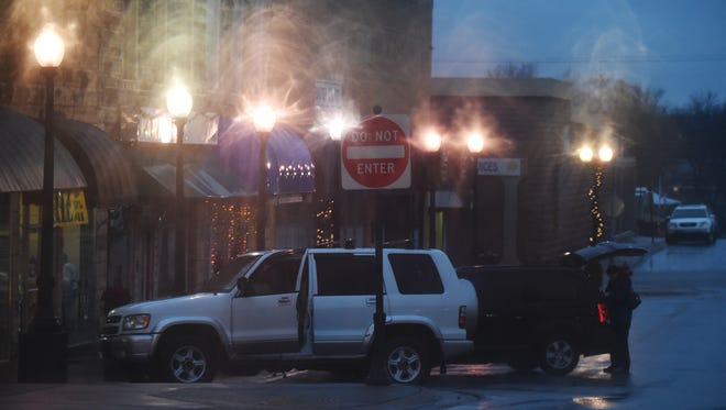 Rain falls in downtown Mountain Home Friday evening. Rain is forecast throughout the day Saturday.